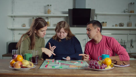 Hearing impaired people playing board game at home Live Action