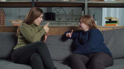 Happy females talking using sign language indoors Live Action
