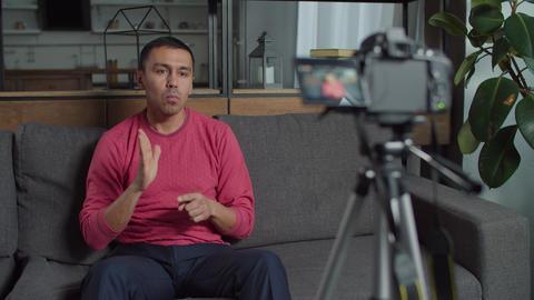 Deaf web influencer streaming sign language vlog Live Action