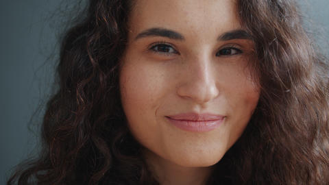 Close-up slow motion portrait of charming mixed race woman smiling with happy Live Action