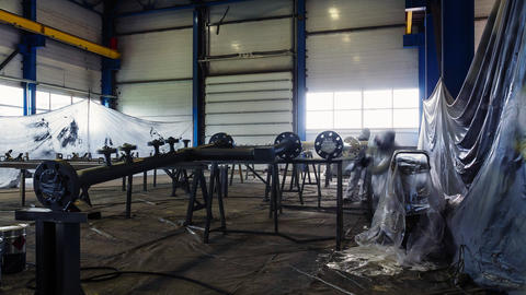employees with sprayers paint pipeline in workshop timelapse Live Action