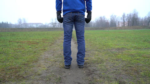 loneliness concept, man alone standing on the street rear view, wearing boxing Live Action