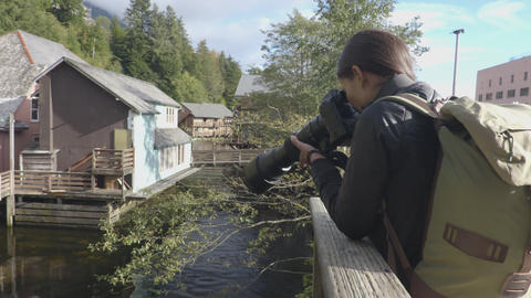 Alaska tourist photographer in Ketchikan Creek Street in Alaska Live Action