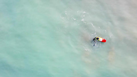 Sporty man paddling on a SUP board. Overhead view Live Action