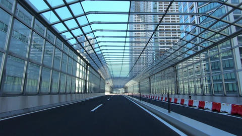 Driving image of a fenced road Live Action