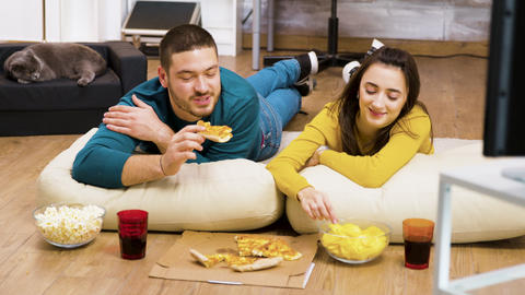 Attractive couple relaxing on pillows for the floor Live Action