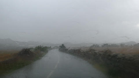 Driving under heavy rain on a lonely road. Time Lapse Live Action