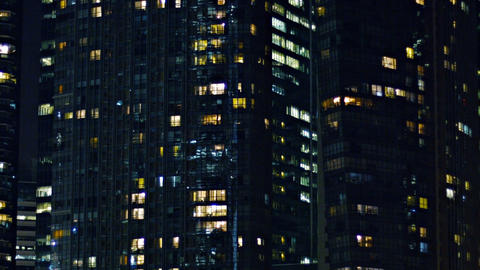 Closeup of backlit windows on contemporary. urban towers at night Footage