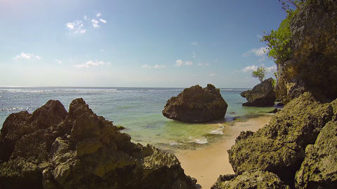 Peaceful Waters Wash over a Rocky Tropical Beach at Low Tide Footage