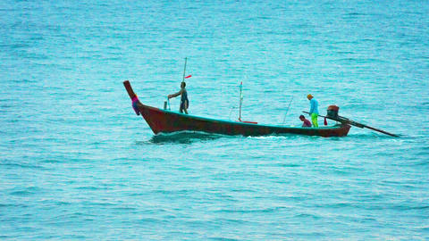 Local Fishermen Pilot their Longtail Boat past a Tropical Island in Thailand Footage