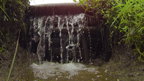 Water of an Irrigation Canal Flows Over a Wooden Dam Footage