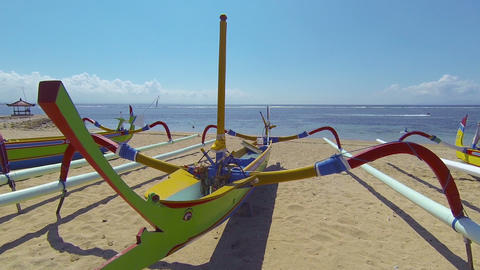 Traditional Outrigger Boats Beached on the Sand at a Resort Footage