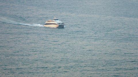 Sleek. Modern. Motor Yacht Cruising through a Hong Kong Bay Footage