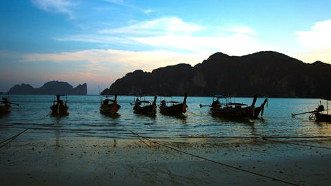 Longtail Boats Tied on a Tropical Beach at Sunset Footage
