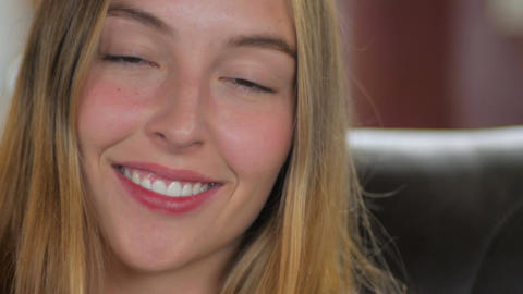 Close up portrait of a attractive young female model turning and smiling at the  Footage