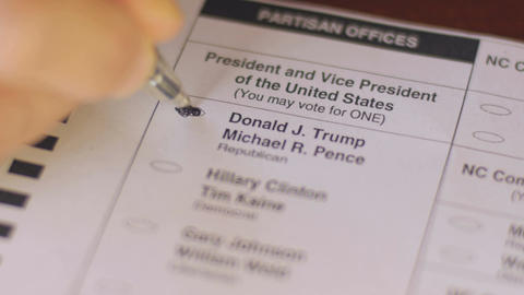 Close up a voter voting for the Republican Donald Trump and Michael Pence with a Footage