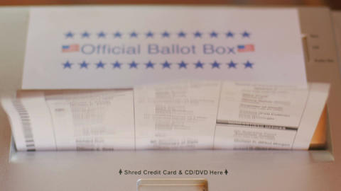 Multiple voter ballots are put into a paper shredder labeled as an Official Ball Footage
