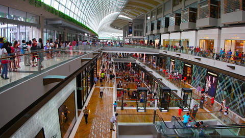 Customer flow inside of big shopping mall The Shoppes at Marina Bay Sands Footage