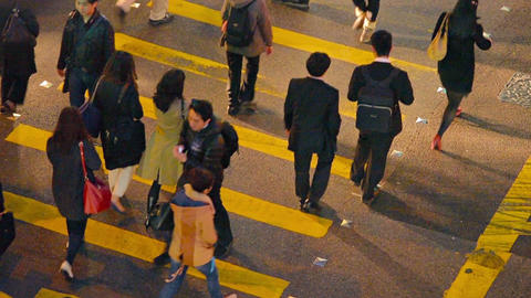 Many asian pedestrians pass big cross road at night time Footage