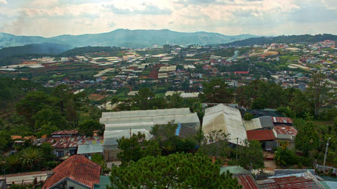 Upper View of Wide Town with Small Houses among Hills Footage