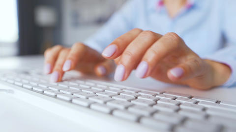 Female hands typing on a computer keyboard. Concept of remote work Live Action