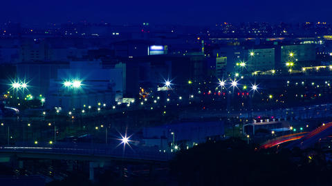 A dawn timelapse at the urban cityscape in Tokyo high angle long shot zoom Live Action