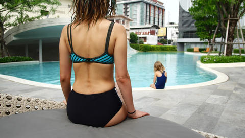 Family on vacation at the hotel. Mom and daughter near the pool Live Action