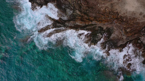 Top view of a deserted coast. Rocky shore of the island of Tenerife. Aerial Live Action