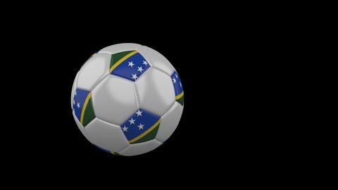 Solomon Islands flag on flying soccer ball on transparent background, alpha Animation