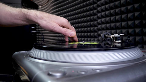 DJ's Hand Mixing and Scratching Vinyl Disc in Professional Record Studio Live Action