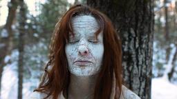 Mystical shaman healer in winter forest Live Action