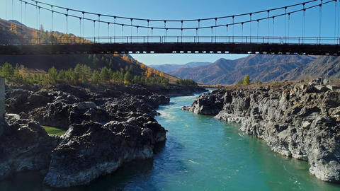 Suspension bridge over the mountain river Live Action