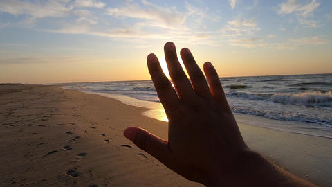 Slow motion. POV of hand of man who moves it in air, through fingers Live Action