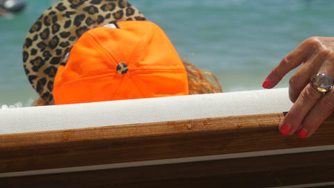 Backside view of youthful old woman lying on the sunbed Live Action