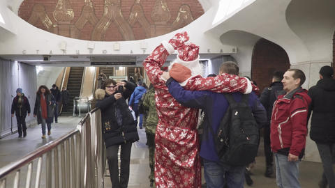 Santa Claus in a suit at the metro station Arbatskaya Live Action