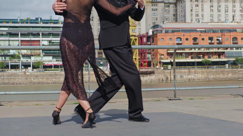 A couple of dancers doing a intimate tango in luxurious Puerto Madero docks Live Action