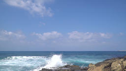 Great waves splashing high to the sky at the shore, half speed Footage