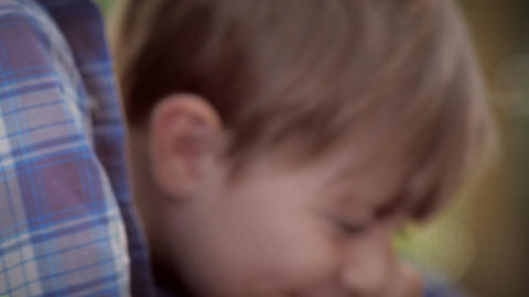 Slow motion close up portrait of a father wearing glasses and a young toddler so Footage