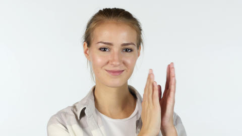 Young Female Student Clapping In Front Of White Background Footage