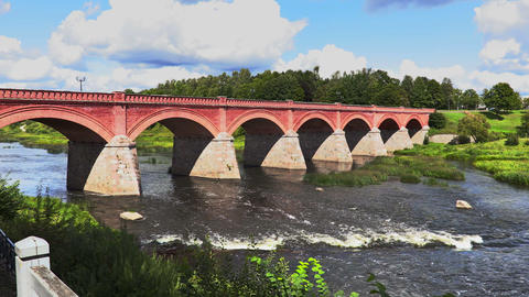 Old stone bridge over the river in summer Footage