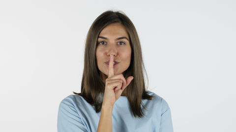 Finger on Lips, Silence Gesture by Beautiful Girl, White Background in Studio Footage