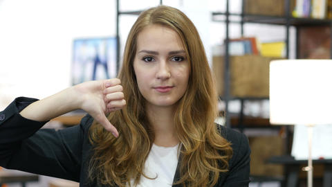 Thumbs Down by Young Girl at Work, Unsatisfied in Office Live Action