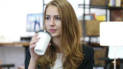 Drinking Coffee, Portrait of Pensive Working Girl in Office Footage