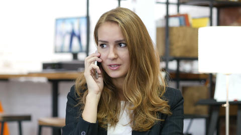 Portrait of Working Girl, Talking on Phone at Work Footage