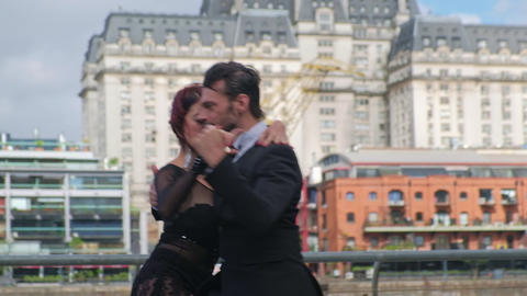 Couple of attractive tango dancers performing with passion in Buenos Aires Live Action