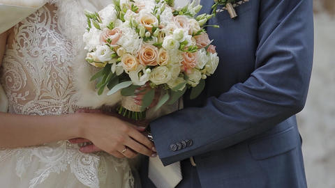 Happy newlyweds caress each other's hands Live Action