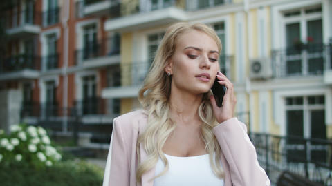 Closeup businesswoman walking in suit. Businesswoman talking phone outdoors Live Action