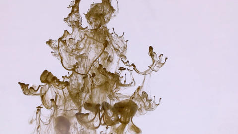 Droplet paint under water and move of brown ink. Abstract swirls of brown colors Live Action