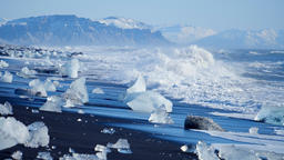 Ocean waves washed icebergs. Ice and Snow Winter Landscape Global Warming Live Action