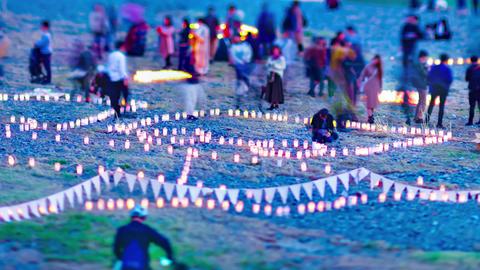 A dusk timelapse of burning romantic candles medium shot tiltshift zoom Live Action